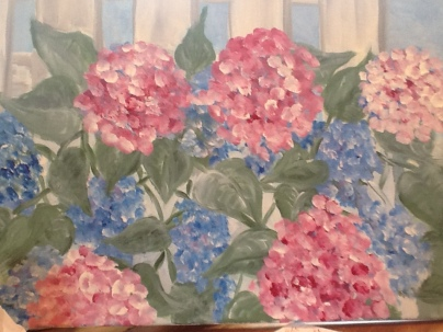 Pink hydrangeas with picket fence